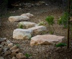 Large limestone boulders with plantings