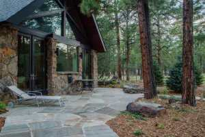 Quartsite flagstone patio with perennials plantings and malpais fire feature