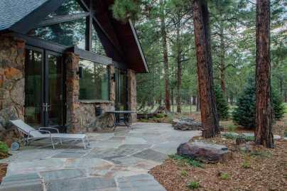 Quartsite flagstone patio with perennials plantings and malpais fire feature