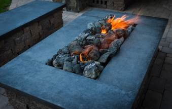 Natural gas firepit and seating area complete with custom made concrete tops