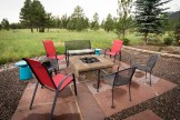 Natural gas firepit atop locally harvested chocolate flagstone patio