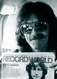 George Harrison displays the November 18, 1974 edition of Record World featuring a fellow named John Lennon on the cover.