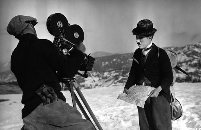 Rollie Totheroh, Chaplin's favorite cameraman, with Charlie during the film of The Gold Rush, 1925 (Photo: Motion Pictures and Television Photo Archive)