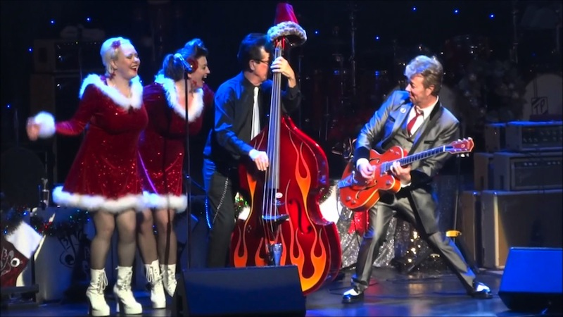 Father Christmas and his elves delivering the rockin' Christmas goods