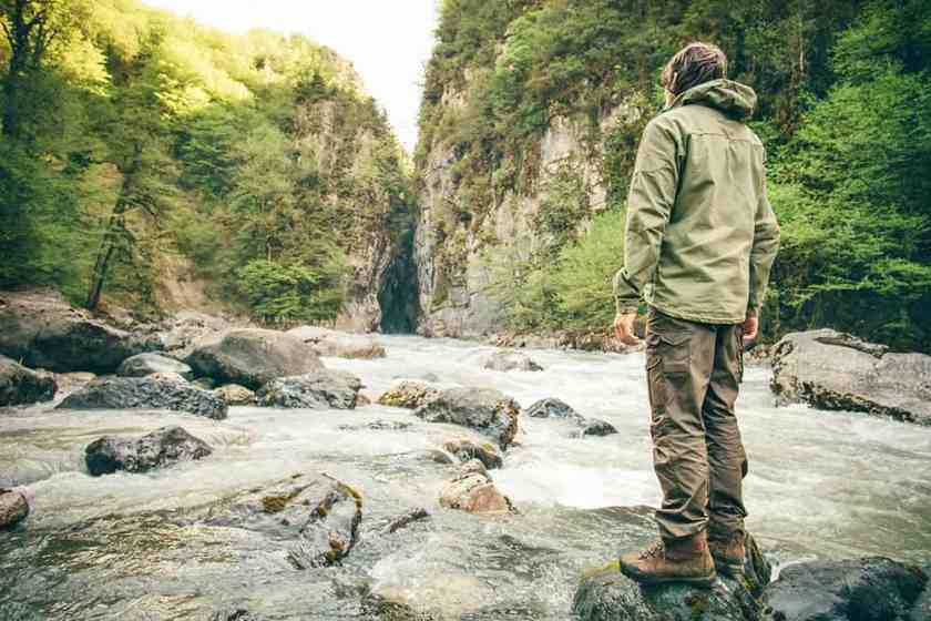Young Man hiking outdoor Lifestyle Travel survival concept