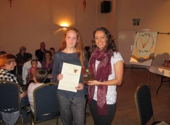 Rachel Lucas receiving the 'Best Junior Beginner' Award from Kirsty Dunleavy