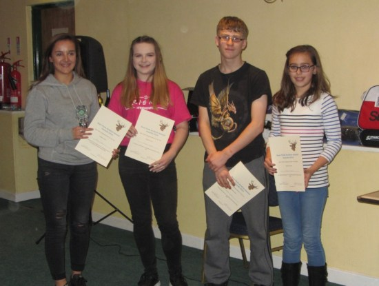 Winner Best Junior Compound Holly Clifford with runners-up.