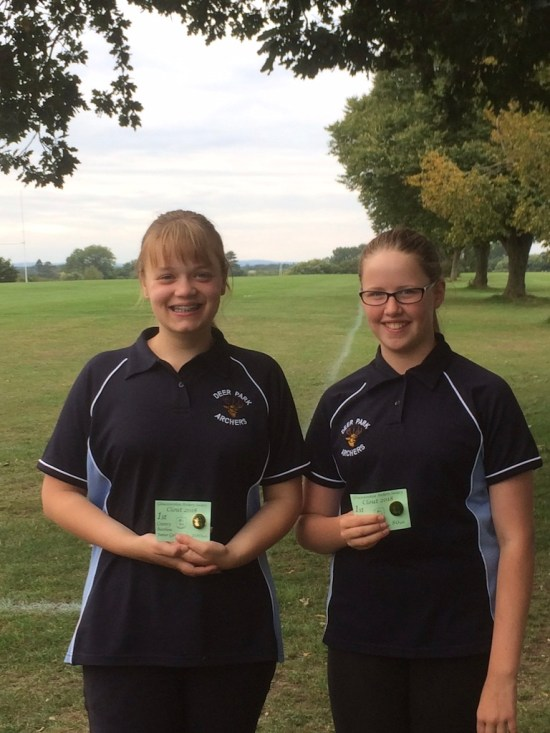 Emily and Imogen showing off their medals!
