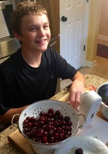 My Son trying out our new Cherry Pitter!
