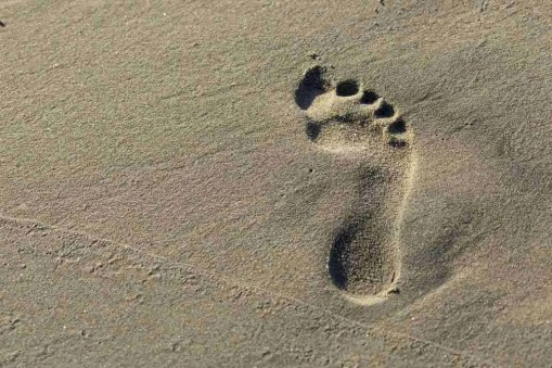Print of a Footprint in the Sand at Huntington Beach California Photo