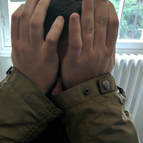 patient showing hand palm eye rubbing