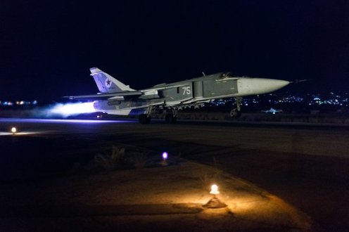 Su-24 taking off at night, loaded with OFAB-250 bombs