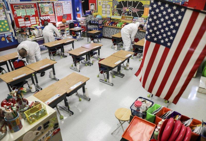 Virus surge: Schools abandon classes, states retreat