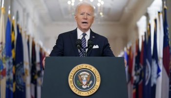 Biden aims for quicker shots, 'independence from this virus'
