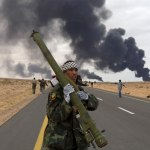Rebel fighter holds an SA7 missile captured from Pro-Gaddafi arsenals in Benghazi.