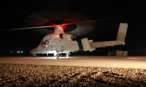 A K-MAX helicopter with Marine Unmanned Aerial Vehicle Squadron 1 rests on a Helipad prior to liftoff for a supply mission in Helmand province, Afghanistan, April 30. The K-MAX has flown more than 400 missions supporting Marines at various locations. Photo: US Marine Corps Cpl. Isaac Lamberth