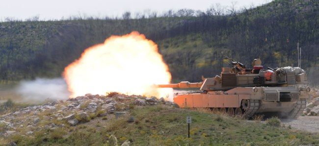 A tank crew from the 1st Battalion, 8th Cavalry Regiment, 2nd Brigade Combat Team, 1st Cavalry Division, at Ft. Hood, Texas fires a 120-mm round from its main gun at a target for crew qualification during a Gunnery Table IV live-fire exercise at Clabber Creek Multiuse Range.
