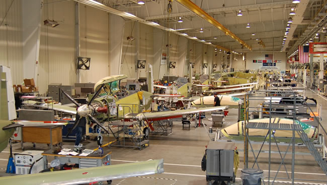 Production line of T-6B trainers at Beechcraft Corp. Wichita plant. The company is protesting the award of the LAS contract to its competitor Embraer. claiming their proposal was lower and potential loss of US jobs. Photo: Beechcraft Corp.