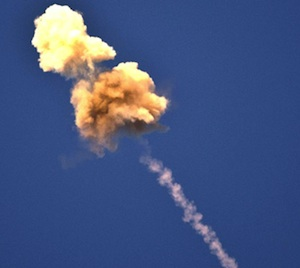 An asymmetric smoke cloud created after an explosion of the Iron Dome warhead near a target. Two 'puffs' are clearly seen.
