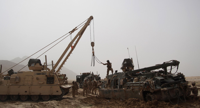 Marines with 1st Combat Engineer Battalion use an M88A2 Hercules to recover an M88A1 after getting stuck in a mud patch, March 16, 2011