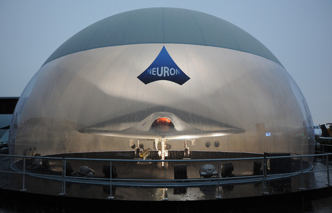 nEUROn UCAV, sheltered from the pouring rain in its styled protective bubble at the 50th Paris Air Show. Photo: Dassault