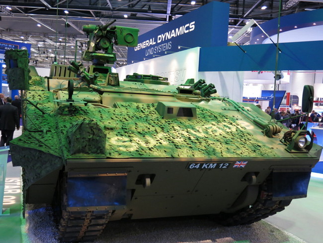 General Dynamics unveiled the FRES SV vehicle at DSEI 2013. One side was coated with a multispectral camouflage, the other remained bare.