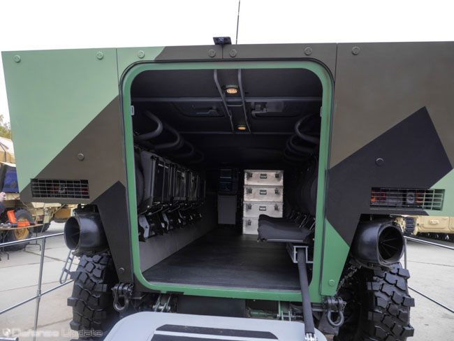 The spacious cabin accommodates eight troops and three crew members. The overhead unmanned turret is mounting the 57mm cannon and up to 100 rounds of ammo. Four containers shown here will provide reloads for the gun. Photo: Noam Eshel, Defense-Update