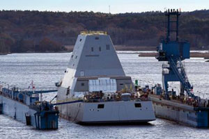 """The Zumwalt floating after the completed launch. """"The launch was unprecedented in both its size and complexity,"""" said Capt. Jim Downey, the Zumwalt-class program manager for the Navy's Program Executive Office, Ships."""