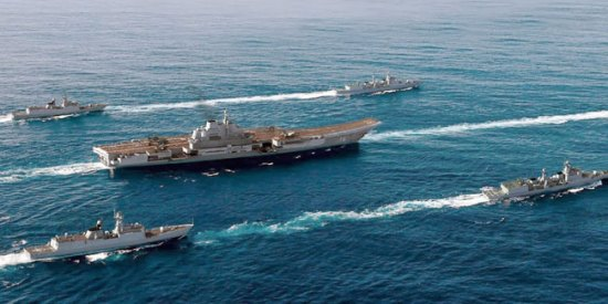 Liaoning (CV-16) escorted by four vessels sets sail to the South China Sea for another training mission.