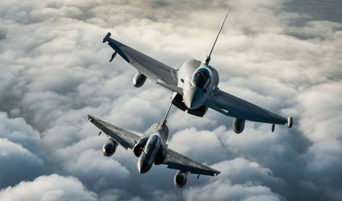 A Royal Air Force Typhoon of 1(F) Squadron (top) and a French Air Force Mirage 2000N practice their formation flying skills during Exercise Capable Eagle in October 2013. Photo: UK MOD, Crown Copyright