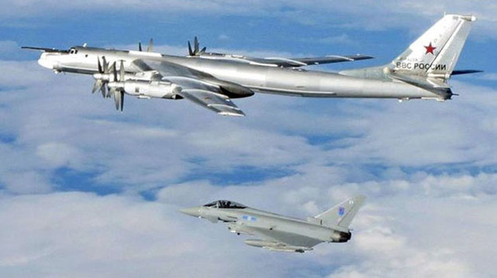 6 Squadron Typhoon from Leuchars escorts a Russian Tu-95 Bear away from British airspace. Photo: UK MOD.