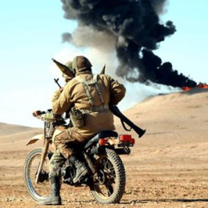 Iranian RPG team deployed on a combat dirt bike.