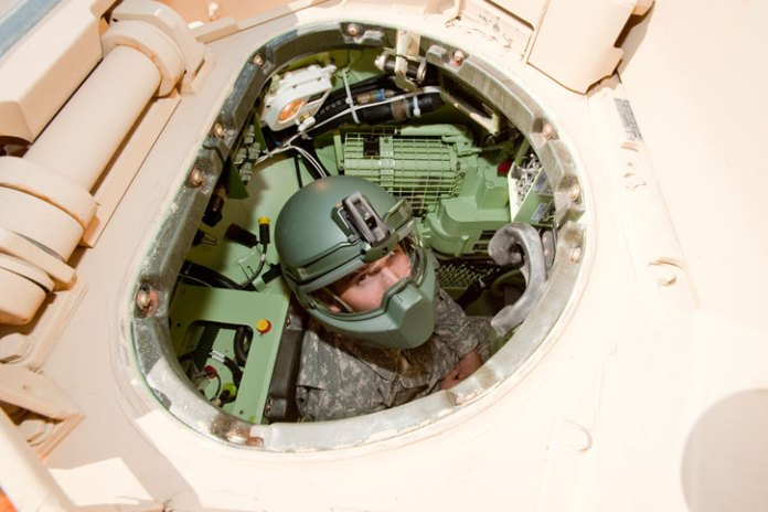 The new integrated helmet technology would eliminate the need for crew members to switch to their Army Combat Helmets when dismounting from their vehicles.Photo: NSRDEC by David Kamm