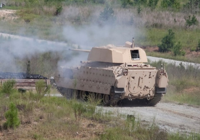 Up-gunned Bradley Fighting Vehicle fires the new XM813 30mm cannon.