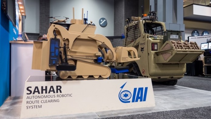 QinetiQ NA and IAI are cooperating in the development of an advanced combat engineering robot, based on remotely controlled Bobcat developed by QinetiQ. The Israeli variant is different from the U.S. Minotaur in its higher autonomy and more comprehensive sensor range. The vehicle on display, called SAHAR uses dedicated IED detecting sensors, and provides a 'mothership' for two additional robotic systems - a Dragon Runner and Hoverlite 4, yet to be announced multirotor drone developed by IAI.