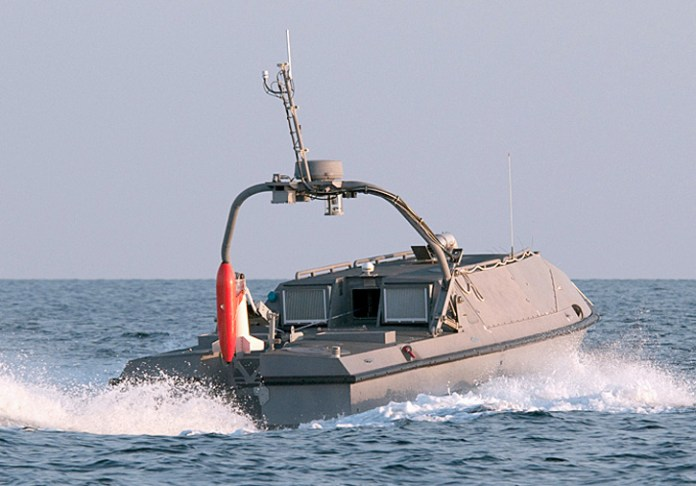 The Unmanned Influence Sweep System prototype performed well in tests during summer 2011. The orange attachment on the back of the vessel is deployed into the water and uses magnetic and acoustic signals to trick mines into exploding.