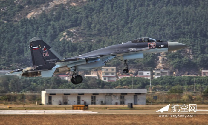 Su-35 touch down at Zhuhai airport, it will be participating in the flight display at Airshow China 2014. Photo: Hangkong