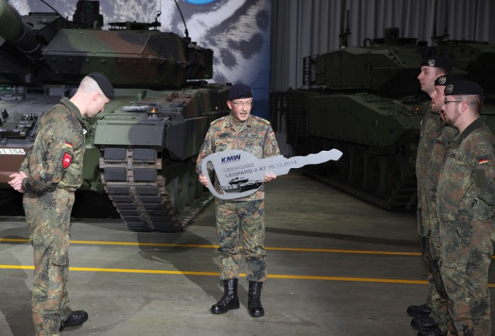 Inspector general of the German Army, Lieutenant General Rainer Korff receives the 'key' for the first of 20 Leopard 2A7 main battle tanks upgraded by KMW to the latest A7 version. Photo: KMW