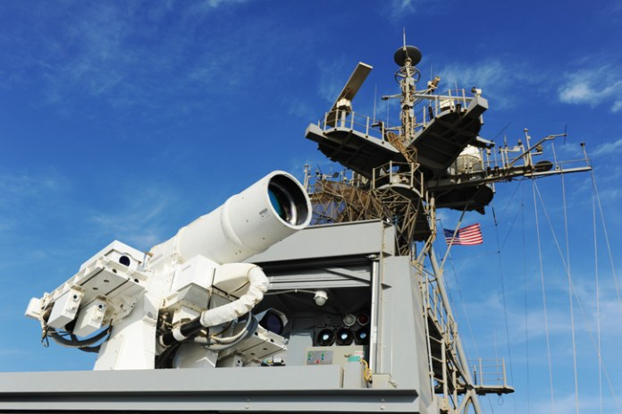 The Afloat Forward Staging Base (Interim) USS Ponce (ASB(I) 15) conducts an operational demonstration of the Office of Naval Research (ONR)-sponsored Laser Weapon System (LaWS) while deployed to the Arabian Gulf. Photo: U.S. Navy, by John F. Williams