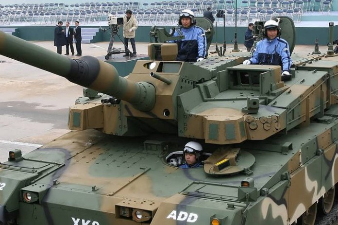 The tank is equipped with day camera, thermal and milimeter-wave sensors, support automatic target detection and tracking under all weather conditions. The tank is well protected with passive and reactive armor suite; additional protection could be added by the integration of a Korean developed Active protection System designed to defeat shaped-charge rounds from close-in distance (10-15 m'). The tank is also provided with radar and laser detecting sensors, that could be coupled with soft-kill countermeasures.