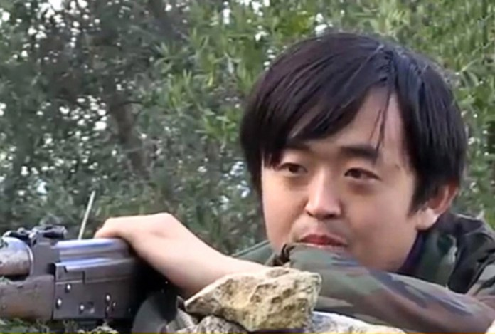 Shown in a video released by ISIS supporters on Youtube, this person, identified as 'Bo Wang' was the first Chinese national openly shown to be fighting with ISIS in Syria.