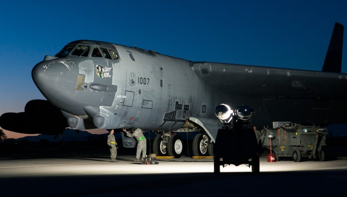 "The ""Ghost Rider"" is prepared for an early morning taxi test on Feb. 12, 2015, Davis-Monthan Air Force Base, Ariz. The B-52H Stratofortress was decommissioned in 2008 and has been sitting in the 309th Aerospace Maintenance and Regeneration Group's ""Boneyard,"" but is being restored to join the active fleet of B-52s. (USAF photo by Master Sgt. Greg Steele)"