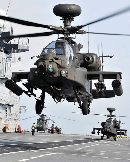 Two Apache helicopters from 664 Squadron, Army Air Corps, perform landing practice onboard HMS Illustrious. Photo: MOD, Crown Copyright, by Dean Nixon .