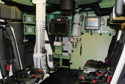 An internal view of the Piranha 5 showing two blast protecting passenger seats, the gunner station remotely operating the Protector overhead weapon station, and the driver station in the far-left side. Photo: GDELS