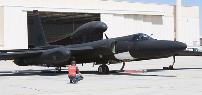 A technician completes final pre-flight checks on a U-2 Dragon Lady before an Open Mission Systems demonstration flight in which fighter aircraft from multiple generations and services exchange penetrating Intelligence, Surveillance, and Reconnaissance, Electronic Warfare and signals intelligence data. Photo: Lockheed Martin
