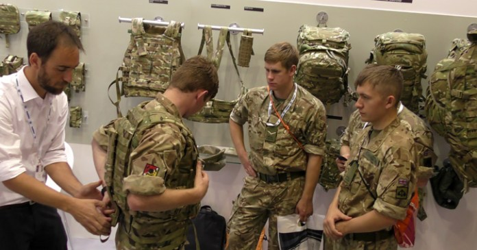 Service members from all branches came to Source's booth at DSEI to experience the new Virtus gear, expected to land at the first units early in 2016. Photo: Tamir Eshel, Defense-Update