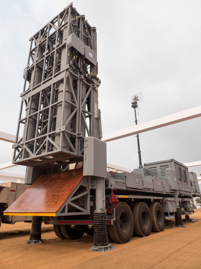 The MRSAM fire unit holds eight ready to launch missiles in two stacks. The missiles are fired vertically from their canister-launchers. To protect the fire unit assembly DRDO developed a unique thermally protected flame deflector that directs the rocket flames away from the trailer. This heat deflector can endure at least 60 launches, without damage. Photo: Noam Eshel, Defense-Update