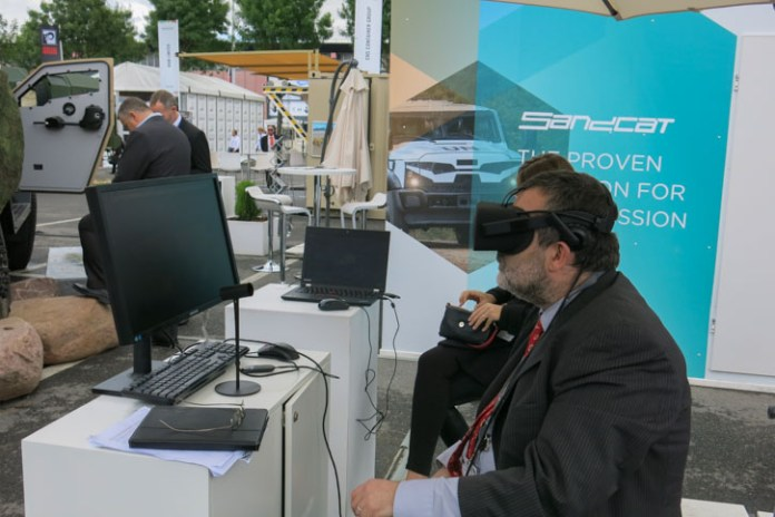 Visitors could experience Plasan's integrated vehicle electronics through an immersive Virtual reality experience. Photo Tamir Eshel, Defense-Update