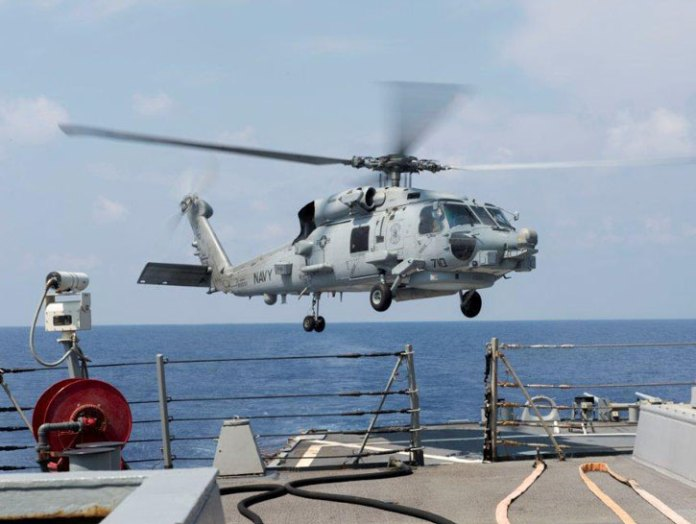 An SH-60F Sea Hawk helicopter prepares to land aboard the guided-missile destroyer USS Gonzalez (DDG 66). Gonzalez is underway participating in a Composite Training Unit Exercise with the Harry S. Truman Strike Group. (U.S. Navy Photo by D. C. Ortega)