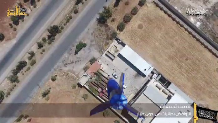 Syrian barracks under attack by bombs dropped from a quadcopter of an unknown type.
